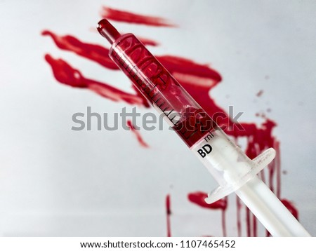 Syringe and blood splats and smears #1107465452