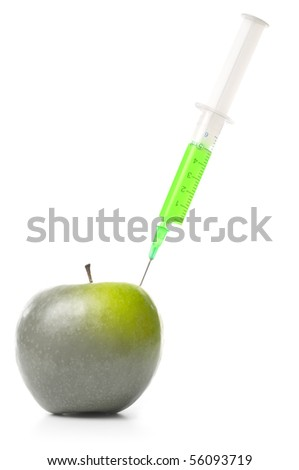 syringe in green apple isolated on white