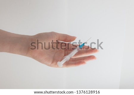 syringe in hand: needle on the palm, injection from the disease, inject medicine, white background #1376128916