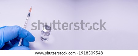 Syringe, medical injection, bottle, ampule in hand, palm or fingers. Medicine plastic vaccination equipment with needle. Nurse or doctor. Liquid drug or narcotic. Health care in hospital. Copy Space Photo stock ©