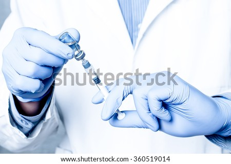 Syringe, medical injection, bottle, ampule in hand, palm or fingers. Medicine plastic vaccination equipment with needle. Nurse or doctor. Liquid drug or narcotic. Health care in hospital.