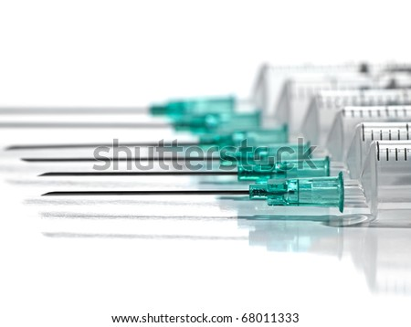 syringes in the row over white background, for  medical,health care or pharmacy themes