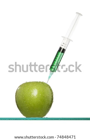 Syringes stuck in an apple
