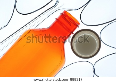 Syrup or liquid bottle.