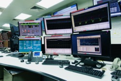 System Control Room IT with many monitor  in a High-Tech Facility That Works on the Surveillance, Neural Networks, Data Mining.