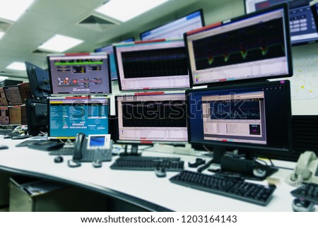 System Control Room IT with many monitor  in a High-Tech Facility That Works on the Surveillance, Neural Networks, Data Mining. #1203164143