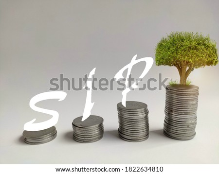 Systematic investment plan concept by increasing coins stack to an aim, Stock photo ©