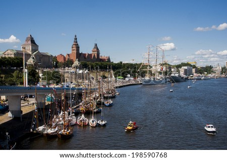 SZCZECIN, POLAND - JUNE 14, 2014: Sail Szczecin 2014.The tall masts of sailing ships fill the harbour for a wonderful three day event.It also has the sailing ship \