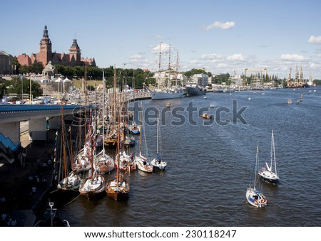 SZCZECIN, POLAND - JUNE 14, 2014: Sail Szczecin 2014.The tall masts of sailing ships fill the harbour for a wonderful three day event perfect for families and those who are sailors at heart.