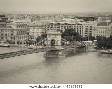 Szechenyi Chain Bridge Is A Suspension Bridge That Spans The River Danube Between Buda And Pest, The Western And Eastern Sides Of Budapest, The Capital Of Hungary, Monochrome Shoot #457678381