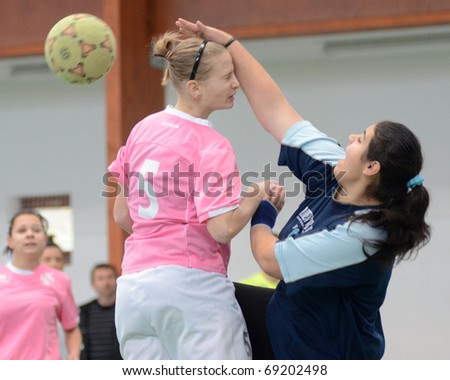 SZENNA, HUNGARY - JANUARY 15: Unidentified players in action at a Somogy Sportja Girl Futsal Competition match between Nagybajom and Kaposvar Toldi on January 15, 2011 in Szenna, Hungary.
