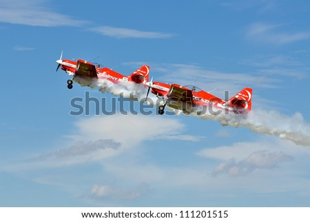 "SZYMANOW, POLAND - AUGUST 25: Aerobatic group formation ""Zelazny"" at blue sky during an air shows ""Air picnic"", on August 25, 2012 in Szymanow, Poland."