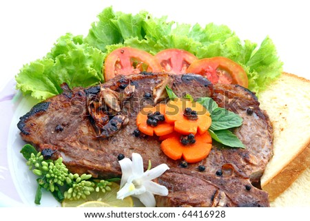 T Bone Pepper Steak with vegetable isolated on white