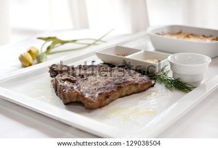 T bone steak serving on plate, T bone steak