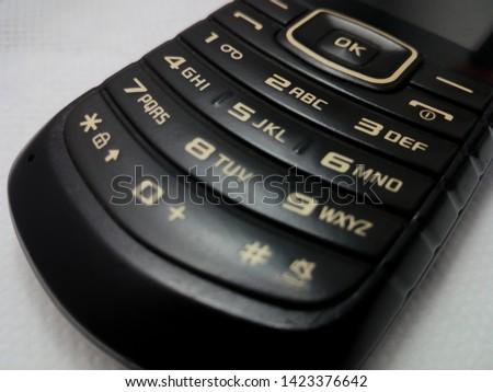 T9 keypad on old black mobile phone  #1423376642
