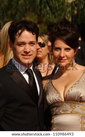 T.R. Knight and guest arriving at the 59th Annual Primetime Emmy Awards. The Shrine Auditorium, Los Angeles, CA. 09-16-07 - stock photo