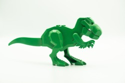 T-Rex toy dinosaur, baby toy, isolated on white background, design element