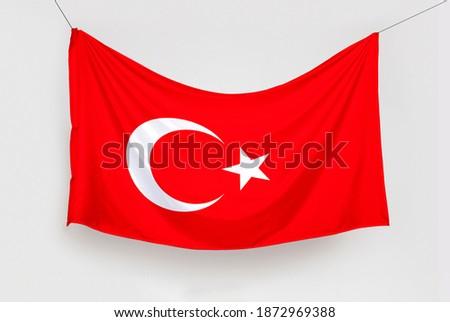Türk Bayrağını Asmak. Translation: Hanging the Turkish Flag, isolated Stok fotoğraf ©