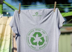 T shirt on washing line with circular economy textiles icon, make, use, reuse, swap, donate, recycle with eco clothes recycle icon sustainable fashion concept