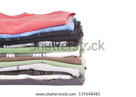 T-Shirts folded and stacked in variety of colors isolated on white