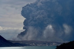 Taal Volcano in the Philippines spews a column of ash. Authorities fear a major eruption will occur in the next few days.