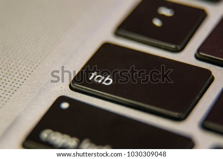 Tab Keyboard key button press type close up macro desktop laptop computer black silver detail technology blog write letter alphabet