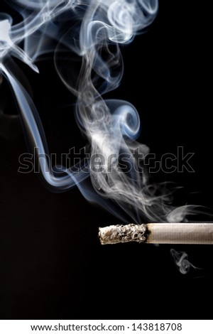 Tabacco and smoke on a black background.