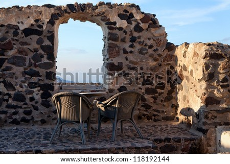Table and chair near the window in  wall of  old house