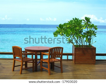 Table And Chairs At Seaside