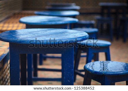 Table and chairs colored in blue