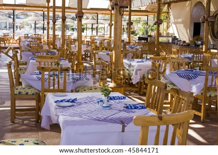 Table and chairs in empty cafe. Hurghada city in Egypt.