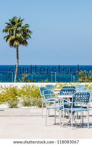 table and chairs in outdoor cafes on the beach