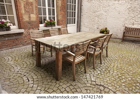 Table and chairs in patio, vintage style