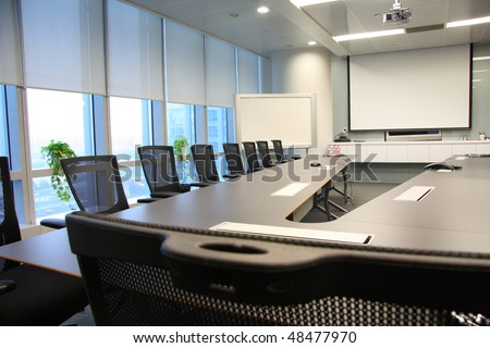 table and chairs in the boardroom