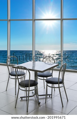 Table and chairs on the sea. Nature composition. #201995671
