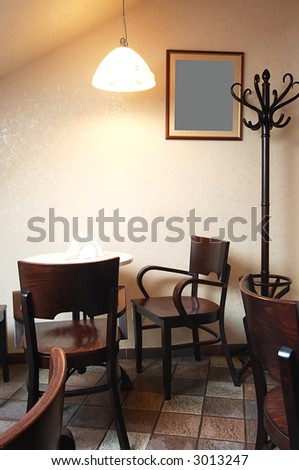 Table and chairs under a lamp in cafe