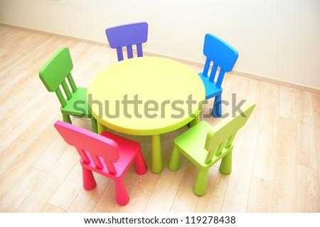 Table and five chairs in Kindergarten Preschool Classroom