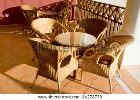 Table and four chairs on patio in the morning