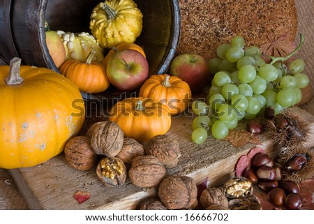 Table and wooden board filled with autumn products