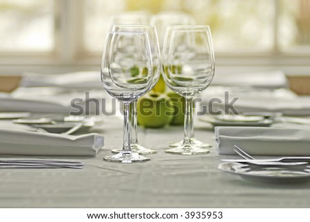 table appointments with apples and wine glasses