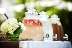 table at a party with lemonade and iced tea