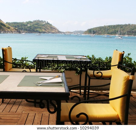Table at a restaurant overlooking ocean views.