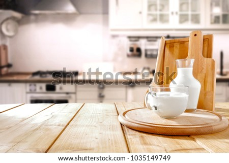 Table background in kitchen and fresh milk