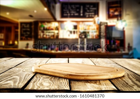 Photo of Table background of free space and blurred background of bar interior.Copy space for your beer or food.