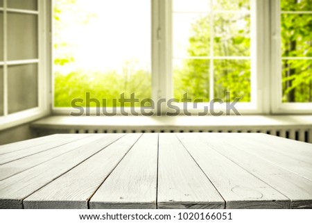 Table background of free space and window with spring view. Empty place for your product or text.