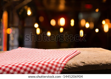 Table background with napkin and blurred bar background space #1445206904