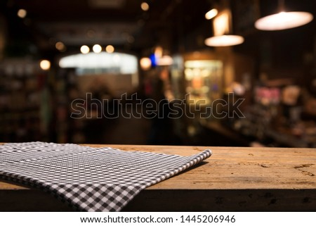 Table background with napkin and blurred bar background space #1445206946
