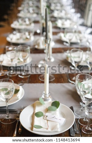 free photos seating card with napkin on a plate for wedding table