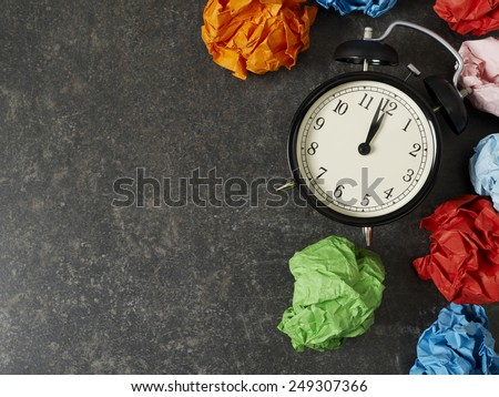Table clock and paper balls with copyspace