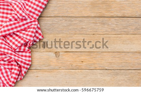 Table cloth red on wood background, top view, copyspace.